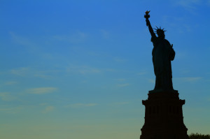 000112 0007 000362 300x199 Views of New York City, USA. Staue of Liberty silhouette at suns